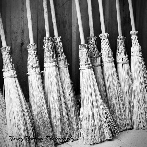 Handmade round corn brooms.