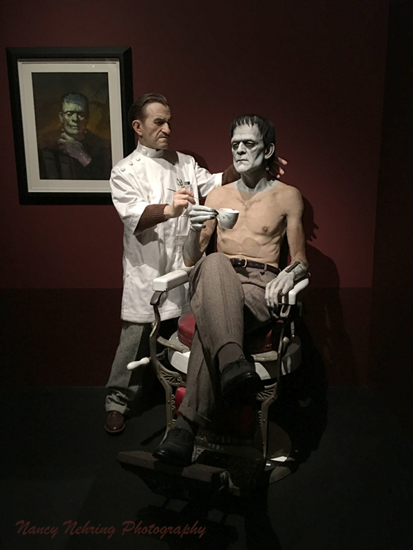 "Creation (of Frankenstein's Monster) 2009 by Mike Hill (England, b. 1969). It's Boris Karloff in the makeup chair and Jack Pierce the makeup artist for ""Frankenstein"". On wall - Boris Karloff as the Monster in Son of Frankenstein by Basil Gogos 1993, acrylic. Guillermo del Toro exhibit, LACMA."