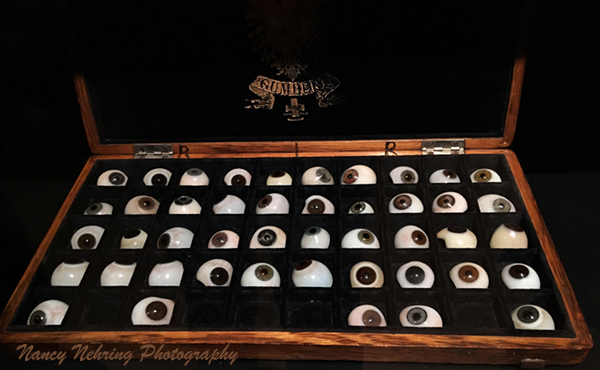 Set of glass eyes of varying colors contained in a mahogany box. Made by Herman Snellen (1834-1908) c. 1860. Louise M Darling Biomedical Library, UCLA Library, Special Collections 1517263BX. Guillermo del Toro exhibit, LACMA.